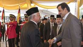 Emir accorded an official reception in Malaysia