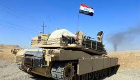 Iraqi forces seize more territory in advance against Kurds