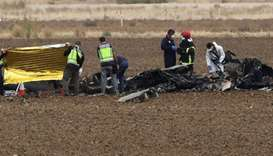 Rescue workers are seen at the crash site of a military F18 fighter plane which crashed at Torrejon