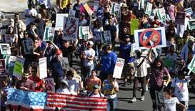 People march as they participate in the '#NoMuslimBanEver' rally in downtown Los Angeles, California