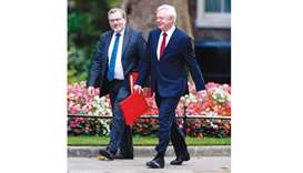 Secretary of State for Exiting the European Union (Brexit Minister) David Davis (right) and Secretar