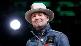 Tragically Hip singer Gord Downie takes part in an honouring ceremony