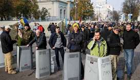 Opposition protesters secure their protest tent camp set up near the Ukrainian parliament building i