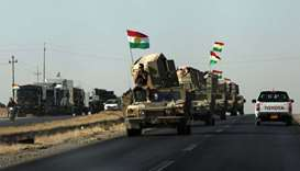 Vehicles of Kurdish Peshmarga Forces are seen near Altun Kupri between Kirkuk and Erbil