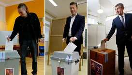 leaders of Czech Pirate Party Bartos, SPD party Okamura and ANO party Babis casting their votes in p
