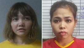 Suspects Doan Thi Huong of Vietnam (L) and Siti Ashyah of Indonesia (R)