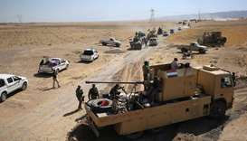 Iraqi forces and the Hashed al-Shaabi advance towards the Islamic State (IS) group's stronghold of H