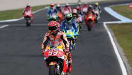 Honda rider Marc Marquez of Spain (front) leaves the track following his victory in the Australian M