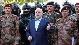 Haider al-Abadi (c) posing for a picture with army generals and members of the counter-terrorism for
