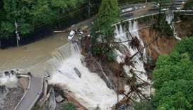 Typhoon Lan heads out to sea, leaves three dead and flooding