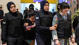 Vietnamese defendant Doan Thi Huong (R) and Indonesian defendant Siti Aishah (2nd, L) are escorted b