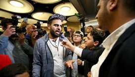 Irish citizen Ibrahim Halawa speaks to the press after arriving at Dublin Airport
