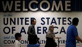 International passengers arrive at Washington Dulles International Airport after the US Supreme Cour