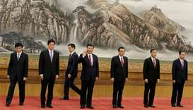 China's President Xi Jinping and other new Politburo Standing Committee members Wang Huning, Li Zhan