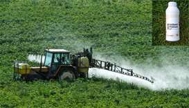 A farmer spraying phytosanitary products (herbicides, fungicides, insecticides) in a field. (inset)