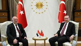 Turkish President Recep Tayyip Erdogan (R) meeting Iraqi Prime Minister Haider al-Abadi at the Presi