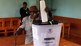 A man casts his vote inside a polling station during a presidential election re-run in Gatundu