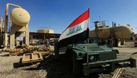 An Iraqi flag is seen on a military vehicle at an oil field in Dibis area