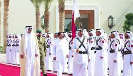 Sri Lankan President Sirisena, accompanied by His Highness the Emir reviews a guard of honour