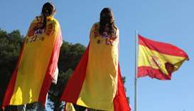 Pro-unity demonstrators wear Spanish flagsin Madrid, Spain