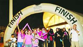 Families participate in Qatar Foundation's breast cancer awareness walk