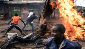 Residents of Kawangware district of Nairobi erect a burning barricade on October 27, 2017 during pos