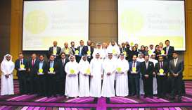 Winners of Qatar Sustainability Awards 2017 with QGBC officials
