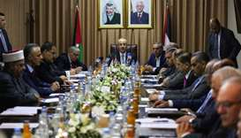 Palestinian Prime Minister Rami Hamdallah (C) chairs a reconciliation government cabinet meeting in