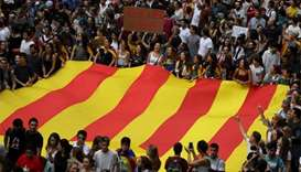 Catalans rally in fury over independence poll violence