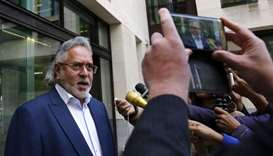 Indian tycoon Vijay Mallya leaves Westminster Magistrates' Court in central London on October 3, 201