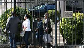 People exit the Embassy of Cuba in Washington, DC on October 3, 2017 in Washington, DC.
