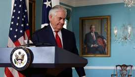 US Secretary of State Rex Tillerson leaves after making a statement to the media that he is not goin