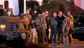 FBI agents confer in front of the Tropicana hotel-casino after  mass shooting