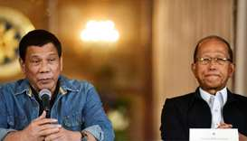 Philippine President Rodrigo Duterte and  Defence Secretary Delfin Lorenzana