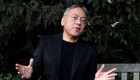 Author Kazuo Ishiguro speaks to the media outside his home