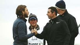 Rory McIlroy shakes hands with Tommy Fleetwood
