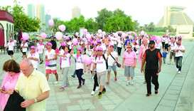 People participate in a QCS event to raise awareness of breast cancer