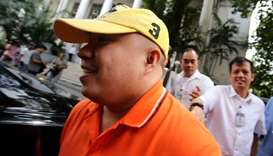 Russel Salic smiling after a hearing at the Department of Justice (DOJ) in Manila