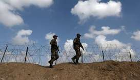 Members of Palestinian security forces loyal to Hamas patrol on the border with Egypt, in Rafah in t