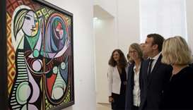 French President Emmanuel Macron (2ndR) and French Culture Minister Francoise Nyssen ((3rdR) view Pa