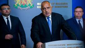 Bulgarian Prime Minister Boyko Borisov (C) speaks during a joint news conference with Bulgarian Inte