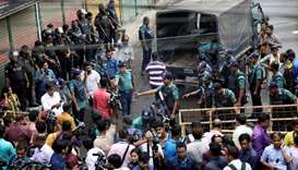 Police block a road near the court during the trial of the August 21, 2004 grenade attack case in Dh