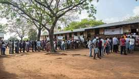 Voters wait to cast their votes for Mozambique's local elections on October 10 at a polling station