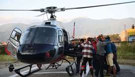 Nepal rescuers retrieve bodies of nine climbers