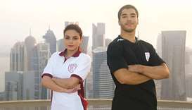 Team Qatar's gymnasts Jana al-Kiki (left)  Ahmed Nabil.