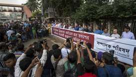 Members of the Newspaper Editors' Council of Bangladesh form a human chain in front of National Pres
