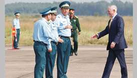 US Secretary of Defence Jim Mattis, right, is greeted by Vietnam's Air Force Deputy Commander Genera
