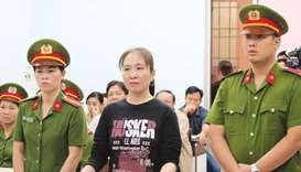 In this file photo, prominent Vietnamese blogger Nguyen Ngoc Nhu Quynh, centre, attending her appeal