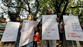 Indian journalists hold placards during a protest against what they say is sexual harassment in the