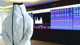 Qatar shares edge lower to settle below 9,200 on banks, industrials